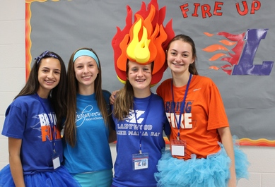 Marketing Booklet Image 6 (Four students in FIRE UP gear).jpg